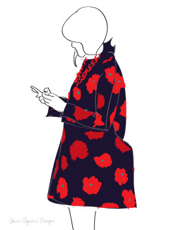 The red floral pattern on this coat with the necklace overlay is very striking.