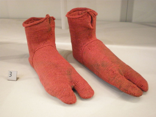 "smithsonianmag:    Taking a Closer Look at a Pair of 1,600 Year-Old Socks  They don't look 1,600 years old, but they don't look new either. And they're bright red! I don't expect something that's over 1,000 years old to look so vibrant. Maybe, too, it's the size. They're so long that they look as if they could fit Shaquille O'Neal's famous size 23 feet—if his feet were also really narrow. After I incredulously posted this image on Facebook this past week and remarked on the antiquity's unique qualities, a friend most succinctly responded with just: #ancientaliens. - Continue reading at Smithsonian.com.  Photo: Victoria and Albert Museum Ed note: Threaded is now on Tumblr. Head on over and make sure to follow!  Particularly intriguing about these ""very useful examples"" is the technique used to construct these red wool socks. Called nålbindning, or single-needle knitting, this time-consuming process required only a single thread. The technique was frequently used for close-fitting garments for the head, feet and hands because of its elastic qualities. Primarily from prehistoric times, nålbindning came before the two-needle knitting that's standard today; each needle was crafted from wood or bone that was ""flat, blunt and between 6 -10 cm long, relatively large-eyed at one end or the eye is near the middle."""