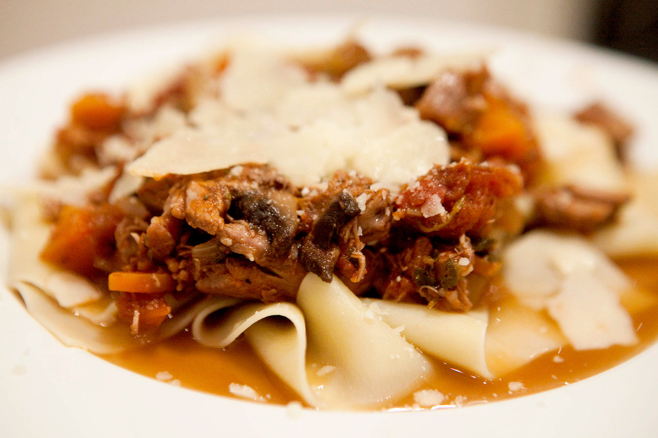Master Stock Duck and Mushroom Ragu with Pappardelle The master stock step here was fairly unnecessary, other than I wanted to cook my duck it in to flavor the stock.  Really, you could butterfly and roast it any way you'd like, just so long as you've cooked it.  Or buy it cooked.  I won't judge. I made the pasta for 2, but the ragu is about 4 serves, so make enough pasta accordingly. Ingredients: 1 whole duck, cooked (mine was cooked for an hour in master stock, then roasted for 20 minutes), then pulled apart into bite size pieces, or a bit larger Cooked pappardelle (pasta), 1 handful per serve 1 onion, diced 1-2 carrots, diced 1-2 celery stalks, diced 2 large portobello mushrooms, sliced 1/2 cup chopped fresh herbs (I used oregano and thyme, but you could also use sage or rosemary) 1 cup red wine 2 tins of chopped tomatoes 1/2 cup of chicken stock Olive oil, salt and pepper Parmesan, to serve In an oven-proof pan with a lid, saute the onions and mushrooms for 3-4 minutes, before adding the carrots, celery, and herbs.  Cook for 5 minutes more.  Add the wine and stock, scraping up any bits from the bottom of the pan.  Stir through the tomatoes and duck, seasoning well with salt and pepper.  Cook in the oven, covered, for about 1 hour, at 170C / 325F.  You'll know it's done when the duck is just about falling apart. Remove the lid and put back on the stove.  Give it a good stir, and put on medium heat until the liquid has reduced and the ragu is thick (as you can see, I got lazy and didn't finish this, so there's some liquid coming out from the ragu).  Put onto the pasta, and top with parmesan.