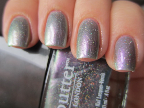 "butter london ""knackered"" i got this off Coterie about a month ago in a 3 for $11 deal! deal of a lifetime seriously! this is a really sheer duochrome with holographic glitter pieces.  this is 3 coats but a normal person might need 4 (since i get bored and glop on the 3rd coat).  amazing color tho!"