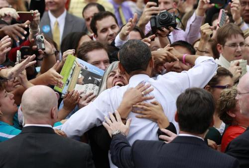 A supporter hugs President Obama during a campaign rally at George Mason University in Fairfax, Virginia on October 19, 2012. REUTERS/Jason Reed