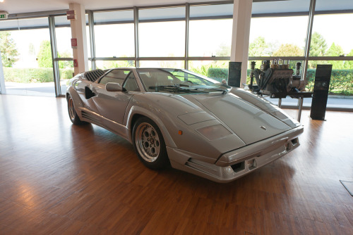 Lamborghini Countach Anniversary. Like every boy in the 80s I had a poster of a Countach on my wall. In fact I had two, one was a big long one somebody got me for Christmas. To my eye the Anniversary of 1988 was a step to far in terms of styling, looking clunky and busy after the purity of the LP500 and 5000QV that went before. The amazing rear end of those earlier models was replaced by a horrible tacked on bumper and square lights. I still have an issue of Fast Lane magazine from the mid-80s when they clocked a Countach QV at a two-way average of 195mph on a public autostrada! Brave men! Sant'Agata Bolognese, Italy.