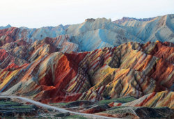 "wnycradiolab:  kayfabe:  Danxia  Danxia refers to a ""type of petrographic geomorphology"" found in China. What that means is you get these mountains that look as though they were decorated with crayons by a five-year-old channelling Dalí.   Wow.  Just, wow.  Going to something similar this winter . Got tickets to the Waves in Utah. Only 25 tickets per day. Had to win the lotto to get it."
