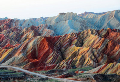 "kayfabe:  Danxia  Danxia refers to a ""type of petrographic geomorphology"" found in China. What that means is you get these mountains that look as though they were decorated with crayons by a five-year-old channelling Dalí."