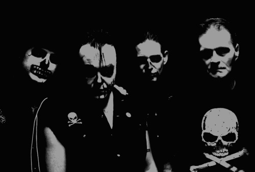 The Howling Bullets are Jordan Sane, Dano Villano, Seanbelly Sewell, Alvin Lapp. Pic by Lily Lemonpie Former members of the Quakes, the von Drats, and Crash Kelly. 100% horror rock!