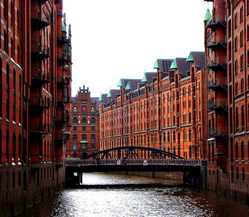 Speicherstadt, Hamburg, Germany by Ferry Vermeer (slowing down) on Flickr.Via Flickr: The Speicherstadt (lit. city of warehouses, meaning warehouse district) in Hamburg, Germany is the world's largest timber-pile founded warehouse district of the world. It is located in the port of Hamburg—within the HafenCity quarter—and was built from 1883 to 1927. The district was built as a free zone to transfer goods without paying customs. As of 2009 the district and the surrounding area is under redevelopment.en.wikipedia.org/wiki/Speicherstadt