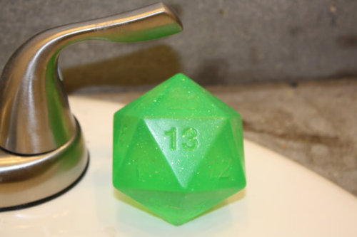 fanboy-news-network:  Twisted Kitten Creations Green D20 Soap- This is a glycerin soap in the shape of an over-sized D20. It is a translucent green with sparkles through out. The sparkles are a soap and cosmetic grade and will not stay on you after using the soap. The scent of Twisted Kitten's green soaps is cucumber melon. Please visit http://www.etsy.com/listing/86319418/d20-soap for more information or to purchase.