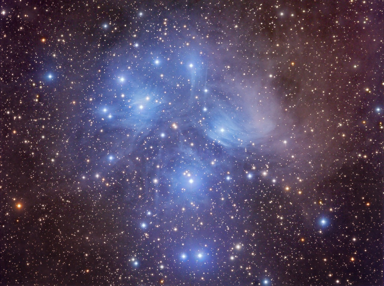 "M45, The Pleiades M45, The Pleiades in natural color, with luminance and RGB combined. For the color I used 10 minute and shorter 5 minute exposures together with the luminance to help prevent the very hot blue stars from becoming bloated.  Total Exposure time 4.75 hours   Clear Skies TerryDown Under Observatory on FacebookDown Under ObservatoryYouTube   Date of Shoot 13th and 16th October 2012 All exposures unbinned Luminance 16 x 5 min, 15 x 1 min RGB 6 x 10 min ea, 7 x 5 min ea. QHY9M monochrome CCD cooled to -30C www.astrofactors.com Thomas M. Back TMB 92SS F5.5 APO Refractor Paramount GT-1100S German Equatorial Mount (with MKS 4000) Image Aquisition Maxim DL Stacking and Calibrating: CCDStack Registration of images in Registar Post Processing Photoshop CS5   Among the closest star clusters is M45, colloquially known as the ""Seven Sisters"".  Due to its close proximity (a mere 440 light-years), and population of extremely hot and luminous stars, it can be easily seen with the naked eye near the constellation of Taurus.  The number of visible stars in this open cluster can quickly tell an astronomer how dark a location is on a night of observation.  Up to fourteen of the more than one thousand stars in M45 can be seen with the unaided eye.  The bright blue clouds surrounding the stars forms a reflection nebula known as the Maia Nebula.  The enormous cloud of dust reflects the light from the hot young stars and was once assumed to be the remnants of the young stars' births, but is now known to be the serendipitous interaction of an unrelated dusty region being illuminated by the open cluster of stars passing through its interstellar neighborhood.  Look closely and you will see the faint brown clouds of dusty material surrounding the cluster.  For comparison here is my earlier shoot from 2 years ago using a Canon 5D II DSLR together with the TMB 130SS http://flic.kr/p/dm2X6V by Terry Hancock www.downunderobservatory.com"