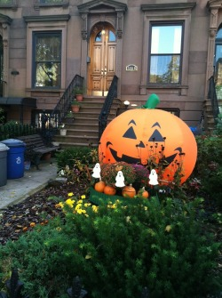 Lindsey: Considering the stroller traffic on this block, this pumpkin is acceptable. Scary: no. Means there's candy in the house? Yes.  Brian: This pumpkin has nothing to be this happy about.  Grade: B-