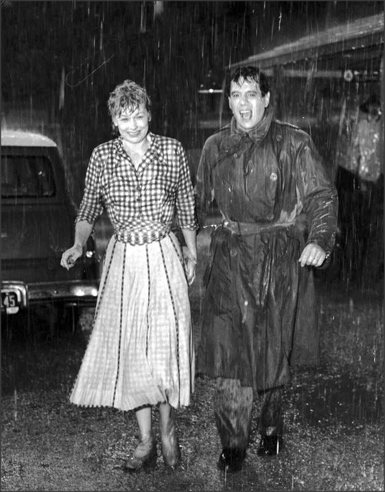 Lucy and Desi caught in the rain, c.1950s TCM