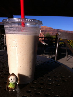 Tiny hobbit enjoys a smoothie from Peace Tree Juice Cafe, in Moab, Utah.
