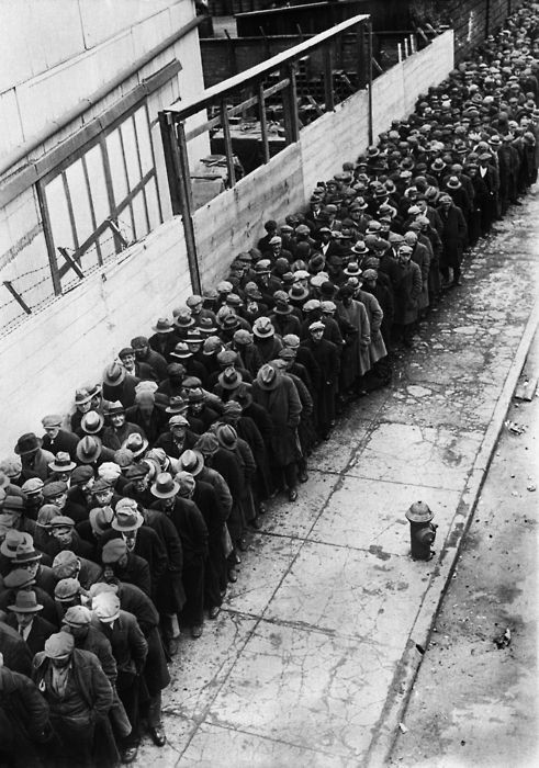 Men waiting in line for an opportunity at a job during the Depression, 1930.