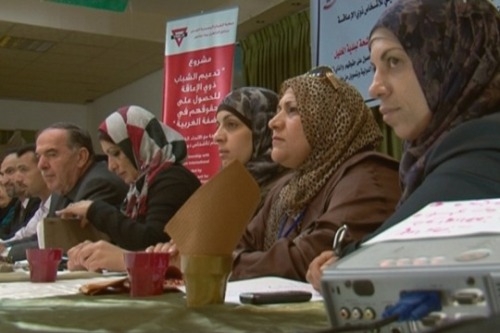 "roxygen:  Palestinian women-only list makes bid for municipal council HEBRON, WEST BANK – On Saturday, Palestinians went to the polls in an election that is being closely watched by the Palestinian Authority and by the international community. The vote for municipal councils is seen as a precursor for parliamentary and presidential elections, even though Hamas is boycotting the vote. Hamas insists the elections, which have been delayed on numerous occasions since their originally scheduled date in 2010, should not take place before Palestinian reconciliation. Meanwhile, in Hebron, an all-female slate – thought to be the first in the Arab world – is contesting seats for the West Bank's most populous city. Headed by Maysoun Qawasfi, a mother of five children aged 7 through 20, she recruited ten other women – as young as 26 years old – to join her. An impressive speaker (in both Arabic and English), Qawasmi works a full-time job for the Palestinian news agency Wafa. She has invested a few thousands of dollars of her own money in the campaign, believing that women can make a difference, particularly in the religiously conservative city of Hebron. […] On Thursday, the last official day of campaigning, I spent the day with Qawasmi in Hebron, a city burdened by Palestinian bureaucracy, and divided and constrained by Israeli occupation. Even as we spoke, Israeli military jets flew overhead. Qawasmi believes that the existing guard – the men – have failed to bring about the changes that Palestinians need, from jobs, to education, and an end to the occupation. It's unclear how well her ""Women's List"" party will do. It consists of eleven candidates vying for spots on the 15-member council. By law, one-fifth of the seats must be reserved for women, and indeed many of the more official parties have women listed on their slates. Qawasmi's independent party may not even get one seat. But she insists she is already a winner."