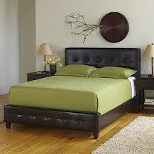 After much hoping and praying, my Draper Espresso Leather Bed has arrived at Cost Plus World Market.  I am moving from the condo I own to a rental - hopefully within a few days - and my master bedroom is too small for the cherry sleigh bed I have had since undergrad.  This bed will balance my feminine bedding perfectly.  It will warm the room in the wintertime and provide sleek elegance throughout the summer.  I can't wait to make the new condo my home.  This bed is just the first step :).
