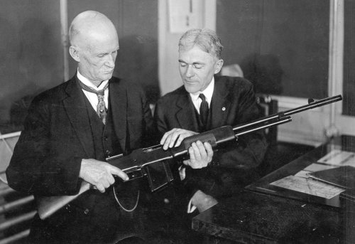 reparations:  peashooter85 John Browning with his invention, the Browning Automatic Rifle.
