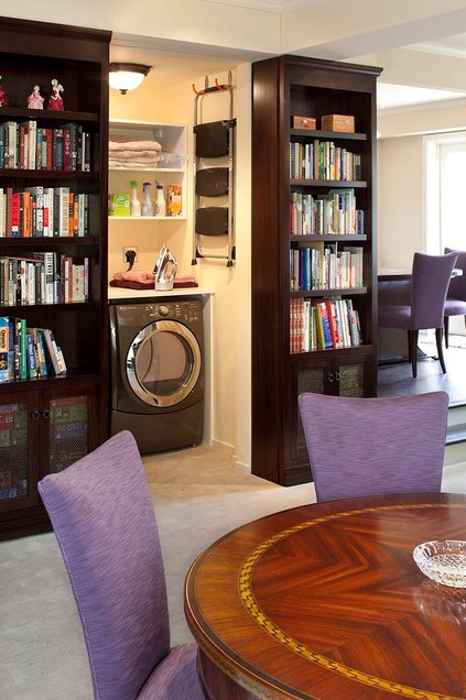 This sliding secret bookcase door conceals a laundry room. It uses skateboard wheels, and could be used to hide any number of different entrances.
