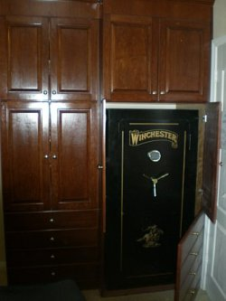 Hidden safe behind custom cabinet doors