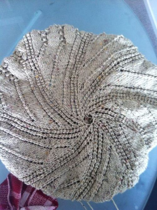 Vortex Spiral Afghan | Wendy Knits Lace My current Work in Progress! It's my first blanket for big people! I have a knitting book called Wendy Knits Lace and it has a lot of amazing patterns. I would highly recommend this book to anyone who's interested in lace. It shows its versatility (for example, really cozy knit hats), because sometimes lace gets a reputation for being super delicate, mind numbingly time consuming, and altogether not very practical. A lot of the patterns are good for mixing and matching yarns, as well. For example, this pattern, when completed in a fingering weight yarn, can be a circular shawl as opposed to a blanket, which is cool. I'm getting really into lace right now, and found a ton of beautiful shawl patterns on ravely that I'm itching to try.  I have another WIP that is a mini shawl that is like bandana sized, but it looks fugly as hell on the needles so you'll only be seeing that bad boy when it has become an #FO