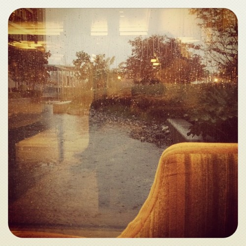 The perfect #vancouver photo - velvet couch & pouring rain