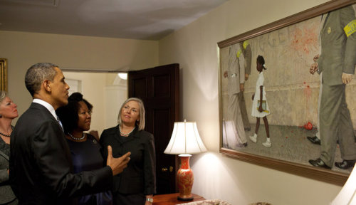 Mr. Obama and Ruby Bridges Hall, the first black child to integrate an elementary school in the South, admiring the Norman Rockwell painting of her marching into school, which he hung outside the Oval Office. Source: NY Times
