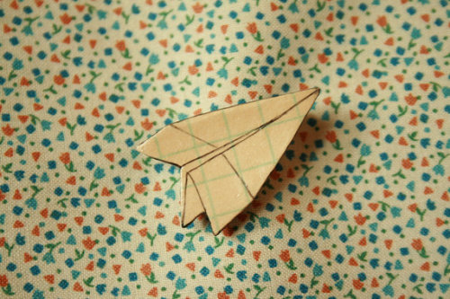 (via Paper Airplane Brooch by stoicandpariah on Etsy)