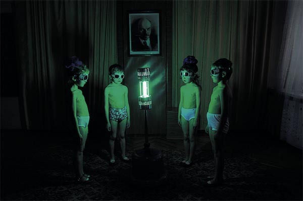 children in Soviet Russia exposing their bodies to a uv lamp to make up for the lack of sun they were getting