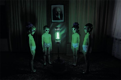 gebeine:   children in Soviet Russia exposing their bodies to a uv lamp to make up for the lack of sun they were getting  hey lil boys n girls u want sum vitamin d - the picture of the guy in the background   I always thought these photos looked like some sort of Cold War Soviet experiment attempting to create super-soldiers by exposing children to various kinds of radiation.