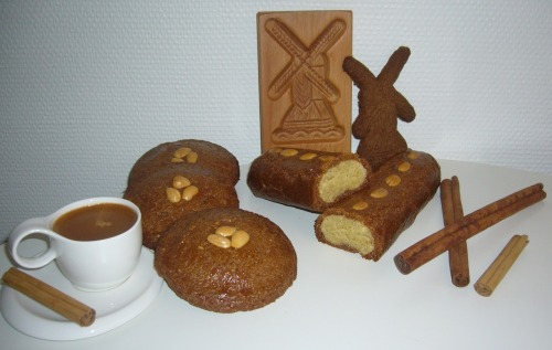 Speculaas, Dutch spiced biscuits or windmill cookies This is a traditional Dutch treat. Everyone loves them! The cookie dough is made with a special spice mix. The mix consists of cinnamon, nutmeg, cloves, ginger and cardamon. The smell when baking these cookies is really delicious. Recipe for Dutch Speculaas: 500 g flour300 g light caster sugar250 g butter 200 g dark caster sugar50 g milk10 g speculaas spices5 g baking powder 30 almonds (for decoration) Blend the flour, sugar, spices and baking powder. Make a hole in the middle of this mixture and add the butter in cubes and add at the milk. Mix the dough with your hands into a soft dough. Let the dough rest in the fridge for 24 hours. It is really important to let the dough rest this long. The spices will develop their flavour. Trust me, this is necessary to make delicious Speculaas. Preheat the oven to 175°C. I used an old Dutch 'Speculaasplank', the wooden cookie mold on the picture, to make a traditional mill. The cookie is often baked in this shape. If you don't have a Speculaasplank, just roll out the dough about 5mm thick and cut the dough in the desired shape. Put some almonds on top, egg wash the dough and bake the Speculaas for about 25 minutes. For the filled ones, roll out the dough and cut out 2 cirkles. Get some almond paste (see the recipe below) and put it on the middle of the first cirkle, brush the sides with some egg wash, this will make the dough stick. Put the second cirkle on top. Brush the top of the dough with egg wash and bake the Speculaas for about 30 minutes. The long 'Speculaasstaaf' needs about 40 minutes to bake. Almond paste 250 gr almonds 250 gr sugar  1 large egg zest of a lemon This is really easy to make. Mix the equal parts of almonds and sugar and grind them in a blender and add the egg and the lemon zest. Mix it really well and cover it with saran wrap and cool. After cooling it is ready to use.  Eat this Dutch treat with a cup of fresh brewed coffee and enjoy!