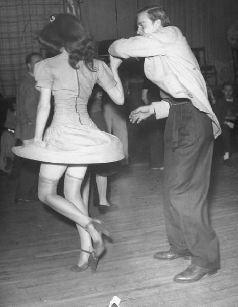 A couple photographed dancing at a Forties swing party