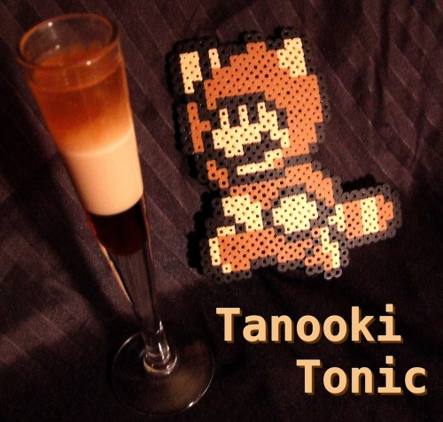 thedrunkenmoogle:  Tanooki Tonic (Super Mario Bros. 3 cocktail) Ingredients:1 part Kahlua1 part Baileys Irish Creme1 part Brandy Directions: Chill ingredients and layer in a tall glass. Kahlua first, then Baileys, then brandy. Drink, serve, then fly away. According to Mel, the drink is sweet but deceiving  just like a trickster tanooki! Drink created and photographed by Mel the Office Gamer Girl.