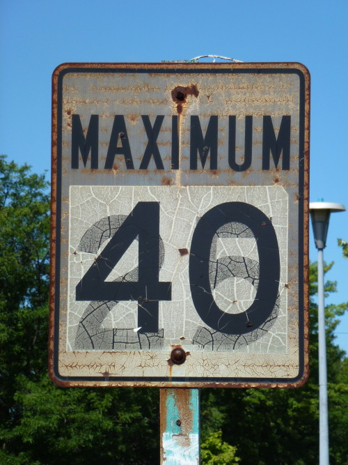 "Metricated speed limit sign in Bolton, Ontario ""In April 1975 Fahrenheit temperatures were replaced by Celsius. In September 1975 rainfall was first measured in millimetres and snow in centimetres. Since April 1976, wind speed, visibility, and atmospheric pressure have been in SI units, with the pressure in kilopascals. In September 1977 every speed-limit sign in the country was changed from miles per hour to kilometres per hour."""