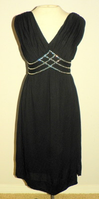 50's Rhinestone Ruched silk Jersey dress https://www.etsy.com/listing/112787768/1950s-black-silk-jersey-draped-wiggle