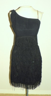 50's One shoulder Fringe dress https://www.etsy.com/listing/112789893/1950s-black-one-shoulder-fringe-and