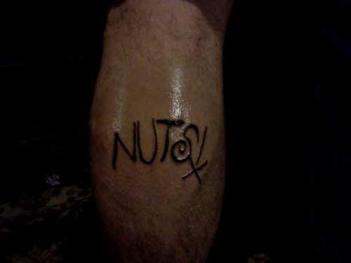 Dylan Espenoza got a Nuts! tattoo!!! by Christina Gemora
