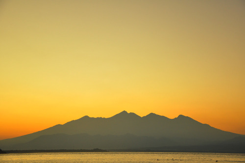 kristikusumo:  Lovely view of Mount Rinjani seen from Gili Trawangan after sunrise. West Nusa Tenggara, Indoensia.