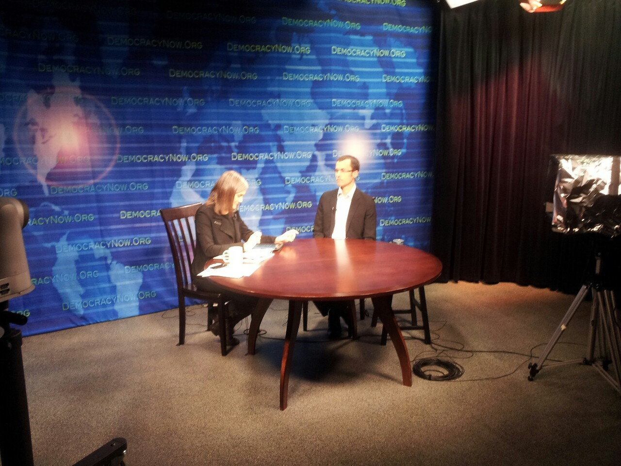 Shane Bauer in studio with Amy Goodman at the Community Media Center of Marin ( http://cmcm.tv ) .  Shane was one of the 3 hikers arrested near the border of Iran and imprisoned for 26 months.  He appeared on DN! for his first live broadcast appearance since being released from prison, to discuss his cover story in Mother Jones magazine, on the use of solitary confinement in the U.S.