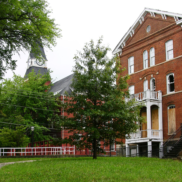 Built in 1869, Atlanta's historic Gaines Hall falls further into decay. Fountain Hall, constructed in 1892, stands in the background.