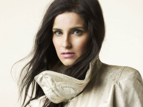 "Nelly Furtado We recently chatted with Grammy-award winning artist Nelly Furtado, who told us about her improvisational technique for songwriting in the studio. Furtado is the executive producer and principle writer on her new album, The Spirit Indestructible. The ""I'm Like A Bird"" singer told us about ""writing on the mic,"" her idea for an alt-rock girl group and more. Let's get this party started. Your remix version of Missy Elliott's ""Get Ur Freak On"" is one of my all-time favorite jams. The notes you chose in the song feel very exotic. How are you able to channel the hip hop persona you used on the song and elsewhere? From the time I had my first band, at age 17, Nelstar, a trip-hop band, I always felt that vocal experimentation was very important and I always found it fascinating. During that time, I developed a style of singing that I called ""skat-singing"" where you sing lots of quick notes very randomly, in different syllabic arrangements. It's equally influenced by the Brazilian Tropicalia movement, jazz music, Hindi music, beat poetry and hip-hop. On ""Freak On"" I wrote the lyrics first, and then improvised the rhythm and melodies while singing it down — it's a very improvisational technique. Glad you asked! Click here to read more"
