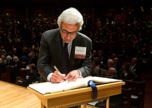 Lincoln Center President Reynold Levy was among 180 influential artists, scientists, scholars, authors and institutional leaders who were inducted into the American Academy of Arts and Sciences at a ceremony in Cambridge, Mass., on October 6. In this photo, he signs the American Academy of Arts and Sciences' Book of Members, a tradition that dates back to 1780.