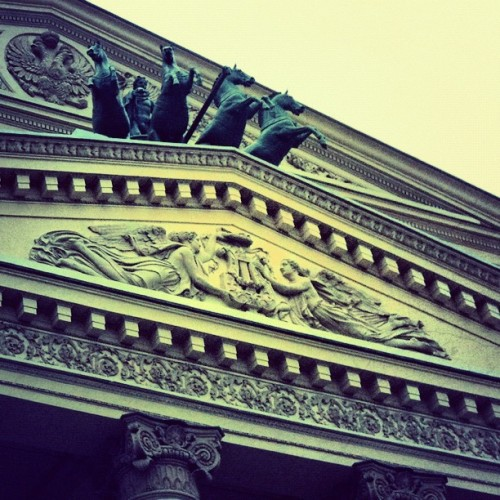 Photo of the #pattern & #statue on the #roof of a #large #theater #downtown #Moscow.
