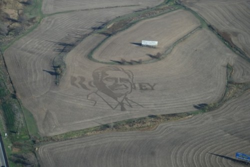 Mitt Romney image shows up in an Iowa cornfield (via Des Moines Register)