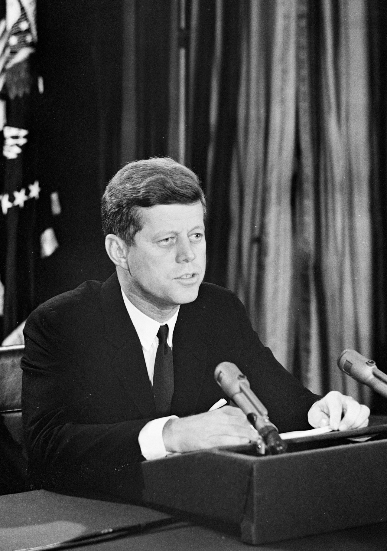 "jfklibrary:  October 22, 1962 — Day 7 of the Cuban Missile Crisis At 7:00 p.m. President Kennedy makes a televised address, revealing the evidence of Soviet missiles in Cuba and calling for their removal. He also announces the establishment of a naval quarantine around the island until the Soviet Union agrees to dismantle the missile sites and to make certain that no additional missiles are shipped to Cuba. Near the conclusion of his speech, JFK says this:  ""My fellow citizens: let no one doubt that this is a difficult and dangerous effort on which we have set out. No one can see precisely what course it will take or what costs or casualties will be incurred. Many months of sacrifice and self-discipline lie ahead—months in which our patience and our will will be tested—months in which many threats and denunciations will keep us aware of our dangers. But the greatest danger of all would be to do nothing.""  Listen to JFK's address and read the full transcript here. Watch a video of JFK's address here. (source: jfklibrary.org)  The National Archives' latest exhibit: ""To the Brink: JFK and the Cuban Missile Crisis"" covers the 13 days when the world teetered on the brink of thermonuclear war."