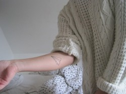 "discoskeletons: ""My first tattoo on my right arm. It's a paper airplane and it's the symbol of the travel of life. You start somewhere and don't know where you end up and so on. It's that simple and that's something I love about life. Life is beautiful! I'm in love."""