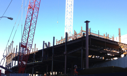 This morning crews installed a steel column which will support the cantilevered fifth floor gallery in our future home downtown! (It's the column right up front with the square piece on top.) When the building is completed, the fifth floor will be the largest column-free museum gallery in New York.