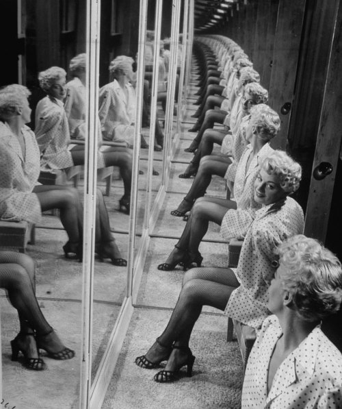 "burnedshoes:  © Allan Grant, 1949, Shelley Winters in a booth with mirrors ""Come on now, we're going to go build a mirror factory first and put out nothing but mirrors for the next year and take a long look in them."" (Ray Bradbury, Fahrenheit 451) » find more photos of famous people here «"