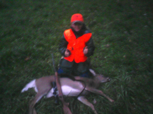 My cousins first deer. May b small but he is too