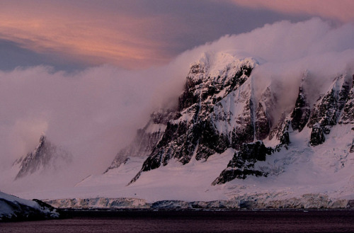 staceythinx:  Scenes From Antarctica is a stunning gallery from The Atlantic's In Focus blog that captures the amazing landscapes and research facilities that populate this harsh territory.   Superb photo tour of the inhospitable and exotic end of the world. See that top photo of the gorgeous sun halo? If you missed it last week, we toured through some of the atmospheric phenomena that you see in pictures like that. It's pretty neat stuff.