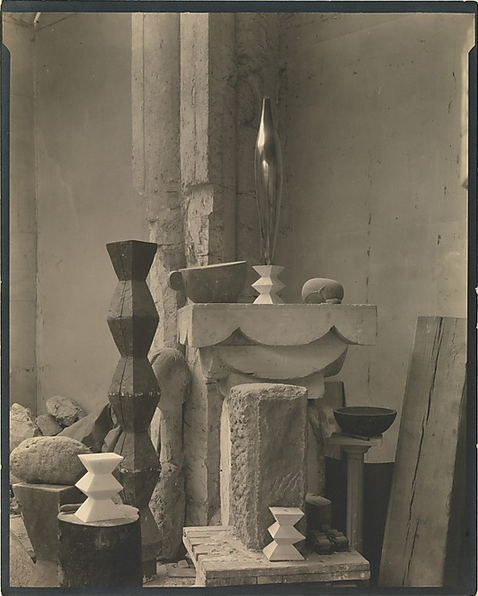 "cavetocanvas:  Edward Steichen, Brancusi's Studio, c. 1920 From the Metropolitan Museum of Art:  Steichen lived in Paris on and off from 1900 to 1924, making paintings and photographs. A cofounder with Alfred Stieglitz of the Photo-Secession, Steichen offered his former New York studio to the fledgling organization as an exhibition space in 1905. Known first as the Little Galleries of the Photo-Secession and later simply by its address on Fifth Avenue, 291, the gallery introduced modern French art to America through the works of Rodin, Matisse, Cézanne, and, in 1914, Constantin Brancusi. Steichen and Brancusi, who met at Rodin's studio, became lifelong friends. This view of a corner of Brancusi's studio on the impasse Roncin shows several identifiable works, including ""Cup"" (1917) and ""Endless Column"" (1918). The photograph's centerpiece is the elegant polished bronze ""Golden Bird"" (1919), which soars above the other forms. Distinct from Brancusi's studio photographs—subjective meditations on his own creations—Steichen's view is more orchestrated, geometric, and objective. ""Golden Bird"" is centered, the light modulated, and the constellation of masses carefully balanced in the space defined by the camera. A respectful acknowledgment of the essential abstraction of the sculpture, the photograph seems decidedly modern and presages the formal studio photographs Steichen made in the service of ""Vanity Fair"" and ""Vogue"" beginning in 1923."