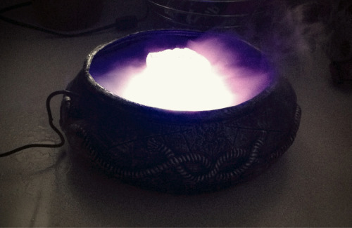 "Testing out the ""misting cauldron"" that we'll be using on the food table for the kids' party.  Pretty cool, if I do say so myself!"