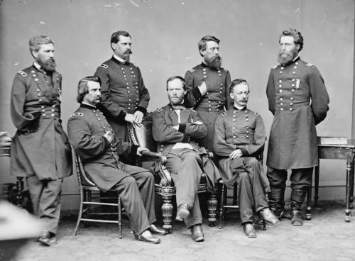 "Before William Tecumseh Sherman became a great Union general, he was demoted for apparent insanity. In October 1861, William Tecumseh Sherman, commander of Union forces in Kentucky, told U.S. Secretary of War Simon Cameron he needed 60,000 men to defend his territory and 200,000 to go on the offensive. Cameron called Sherman's request ""insane"" and removed the general from command. In a letter to his brother, a devastated Sherman wrote, ""I do think I Should have committed suicide were it not for my children. I do not think that I can again be trusted with command."" But in February 1862, Sherman was reassigned to Paducah, Kentucky, under Ulysses S. Grant, who saw not insanity but competence in the disgraced general. Later in the war, when a civilian badmouthed Grant, Sherman defended his friend, saying, ""General Grant is a great general. He stood by me when I was crazy, and I stood by him when he was drunk; and now, sir, we stand by each other always.""  William Tecumseh Sherman and staff. Library of Congress description: ""Gen. U. S. T. Sherman and staff"""